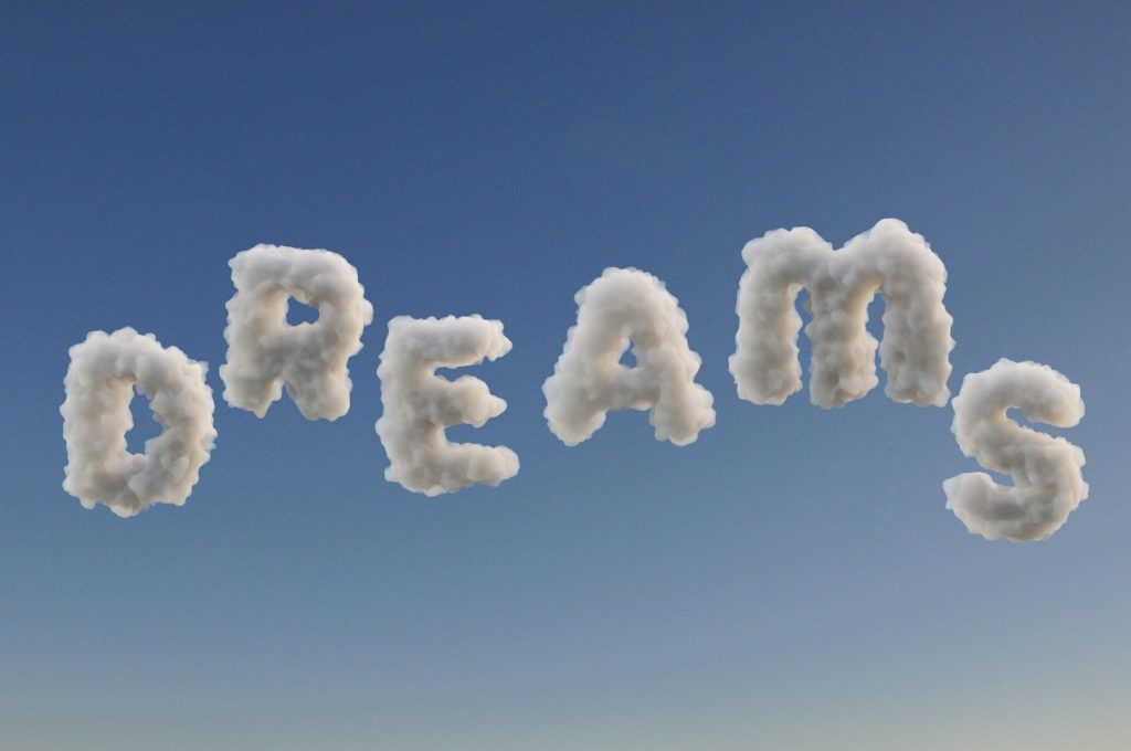 "Picture of little clouds spelling ""Dreams"""