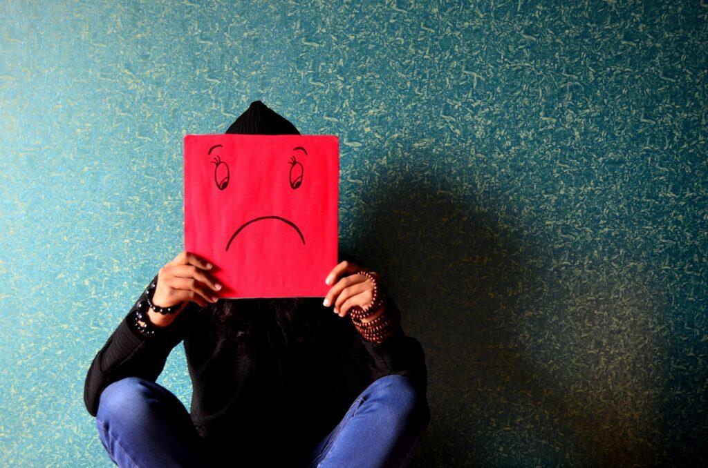 Man behind a sad depressed picture
